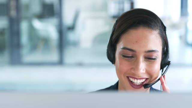 Delivering service with a smile 4k video footage of an attractive young businesswoman working in a call center hands free device stock videos & royalty-free footage