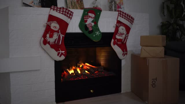 delivery boxes near fireplace. Ecommerce website online shopping delivery ads. delivery boxes near fireplace. Ecommerce website online shopping delivery ads. christmas stocking stock videos & royalty-free footage
