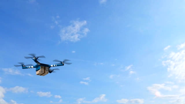delivery drone - drone delivery a cardboard package on an sunny day with blue sky video