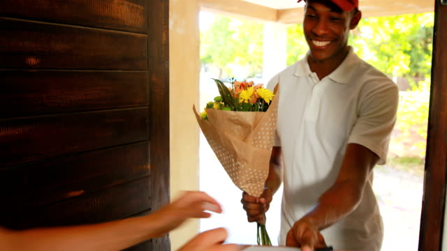 Delivery man delivering flowers video