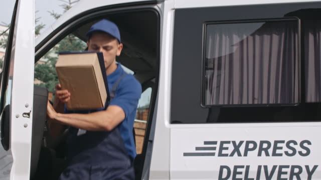 Delivery Man Getting Out From Van