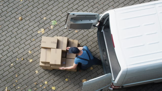 Delivery Man Loads his Commercial Van with Cardboard Boxes. video