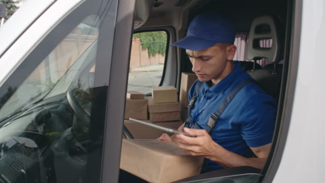 Delivery Man Working on Digital Tablet