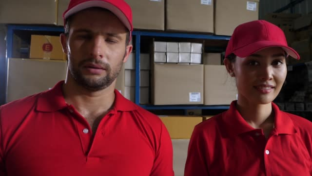 Delivery people holding carton