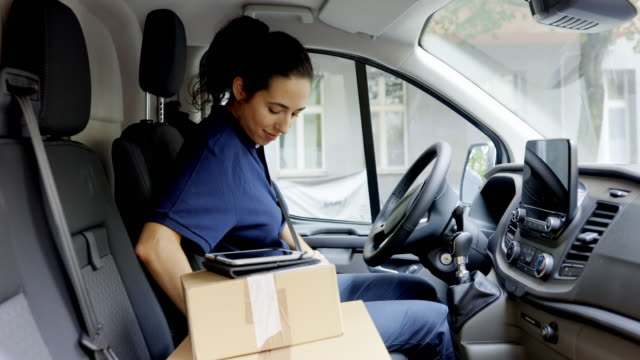 delivery person going for delivering parcel in a van - furgone video stock e b–roll