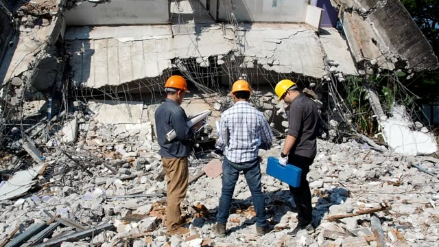Demolition control supervisor teams and foreman discussing on demolish building.