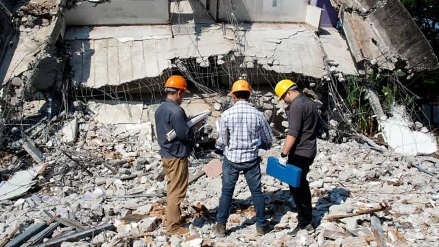 demolition control supervisor teams and foreman discussing on demolish building. - evento catastrofico video stock e b–roll