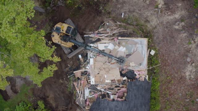 AERIAL demolition excavator tearing down an old building