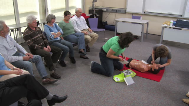 HD: Demonstrating CPR On A Dummy video