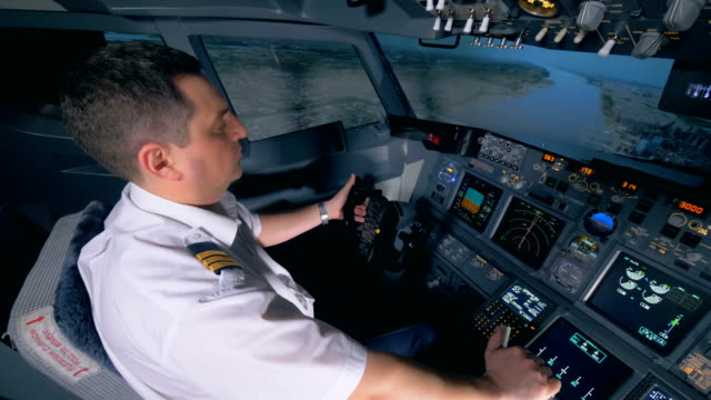 demonstration flight is being performed by a male instructor in a flight simulator - pilota video stock e b–roll