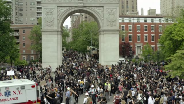 demonstration - peaceful protestors with signs in Washington Square Park