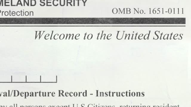vídeos y material grabado en eventos de stock de negó el formulario de inmigración de estados unidos - pasaporte y visa