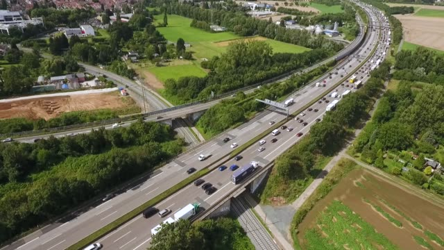 dense traffic on highway - aerial view, drone footage - autobahn video stock e b–roll