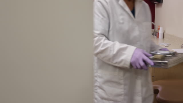 Dental Assistant Grabs Tools to be Cleaned video