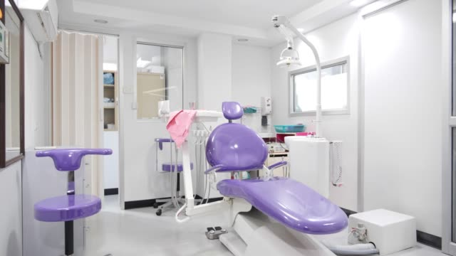 dental clinic interior design with chair and tools medical equipment - dentist stock videos & royalty-free footage