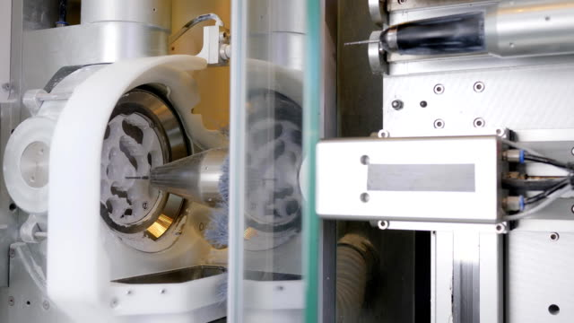 dental Lab, automatic process of milling out exact shape model of artificial teeth video