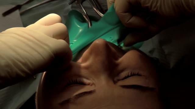 Dentist and assistant making dental filling video