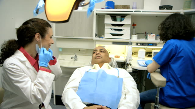 dentist and patient smiles at camera after the checkup video
