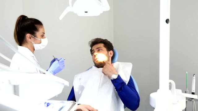 Dentist at work video