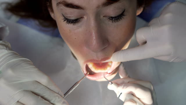 Dentist at work with patient video