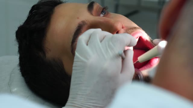 Dentist Drilling A Men Tooth video
