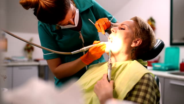 Dentist examining a patient's teeth in the dentist. video