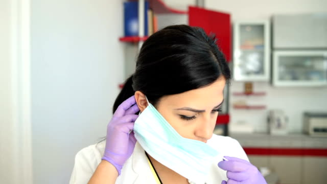 dentist putting on surgical mask - face mask stock videos & royalty-free footage