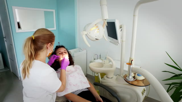 Dentist Teeth Carefully Examines The Patient Girl video