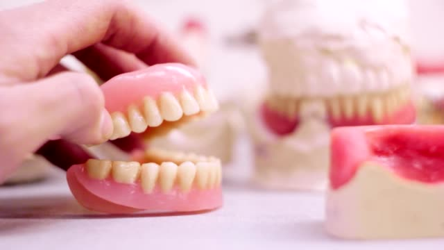 Dentures jaw clicking on the background dental laboratory video