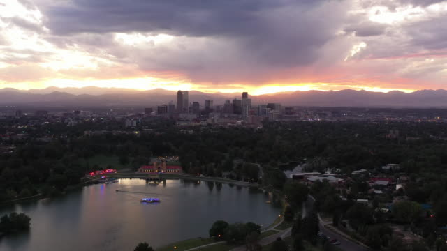 Denver, Colorado City Skyline at Sunset with City Park Lake Aerial Drone