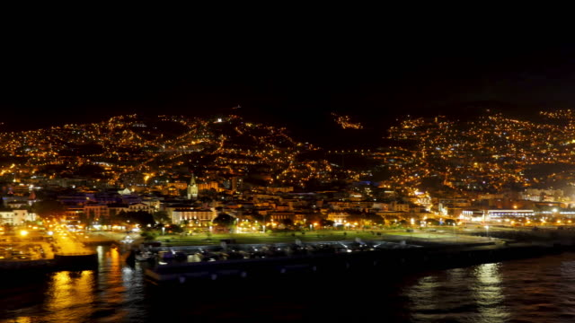 Departure of a cruise ship with a view of Funchal, Madeira at night