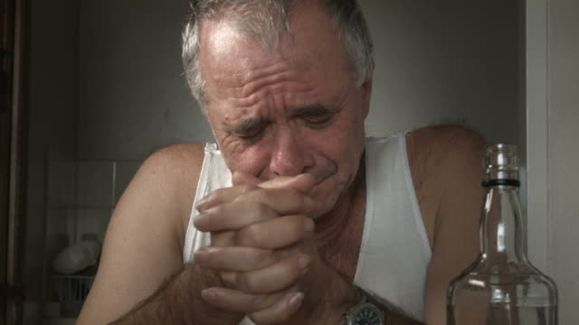 Depressed adult male person crying suffering Alcoholism and Loneliness video