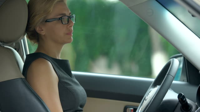 Depressed business woman thinking about dismissal, sitting upset in automobile Depressed business woman thinking about dismissal, sitting upset in automobile relationship breakup stock videos & royalty-free footage