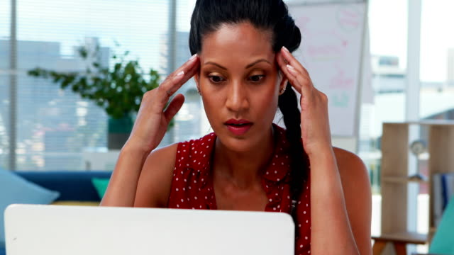 depressed female executive sitting at desk 4k - unemployment stock videos & royalty-free footage