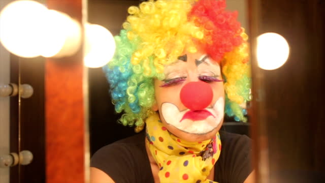 Depressed girl clown crying.