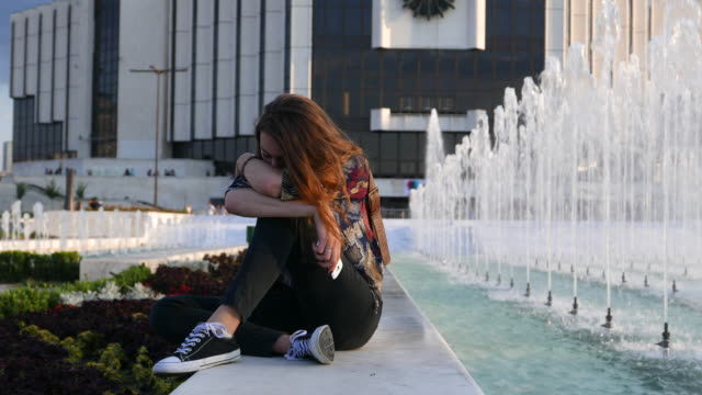 Depressed girl in the city