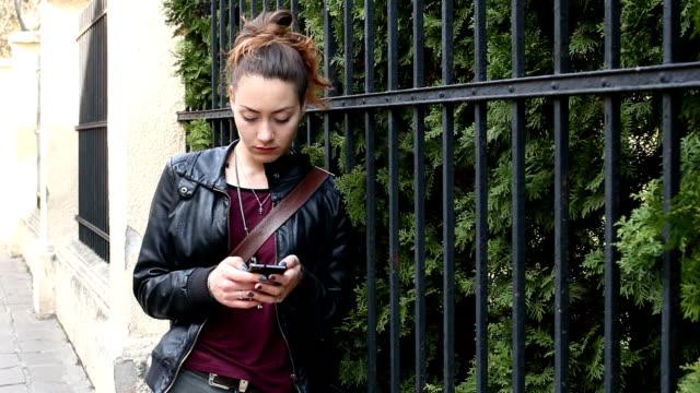 Depressed girl looking at her phone video