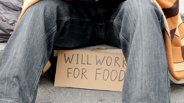 Depressed man trembling from cold, begging for money, homelessness, destitution video