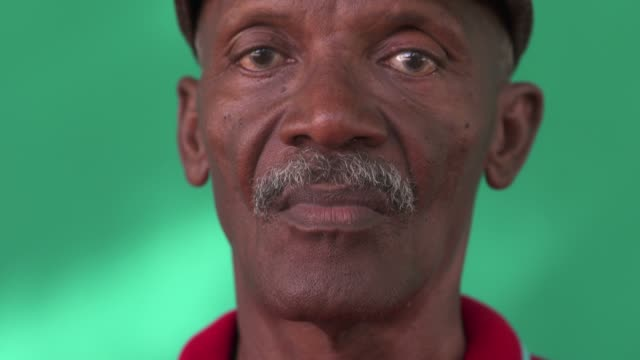 Depressed Old Black Man With Sad Worried Face Expression Real Cuban people and emotions, portrait of sad senior hispanic man looking at camera. Worried old black grandfather with mustache and hat from Havana, Cuba. Close up of face depression land feature stock videos & royalty-free footage