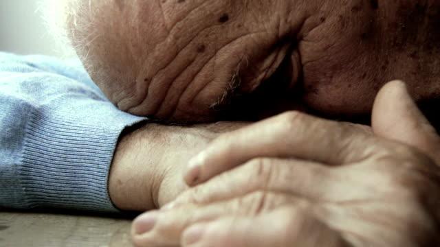 depressed old man sleeps: sleeping elderly man, lonely retired man video