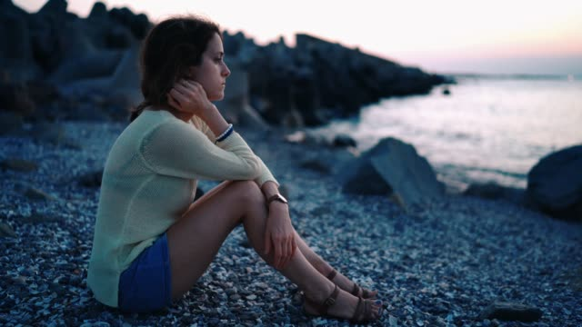 Depressed woman at beach holiday