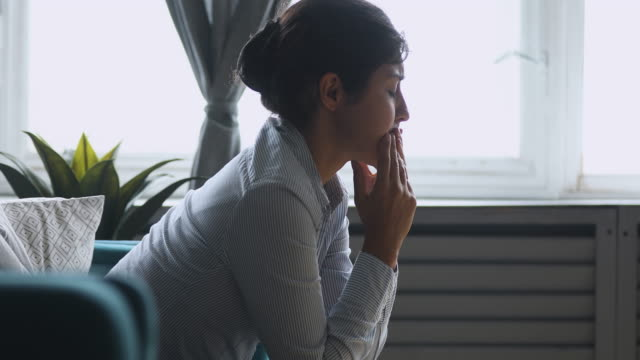 Depressed worried sad indian girl sit alone concerned about problem