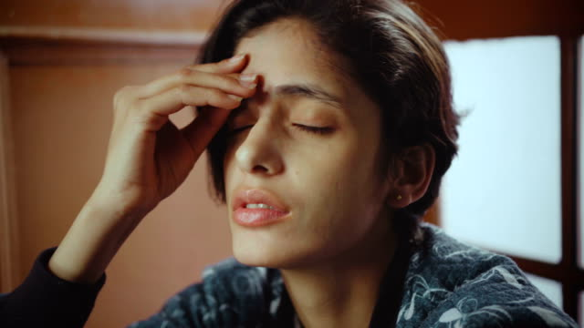 depressed young woman feeling headache. - состаривание стоковые видео и кадры b-roll