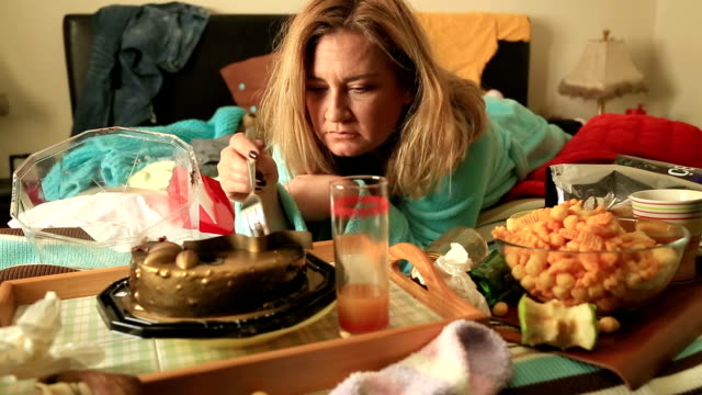 Depressive woman eating cake video