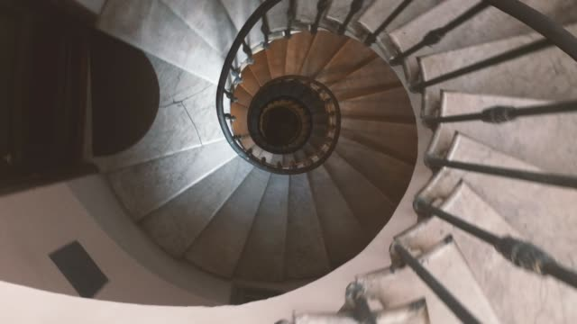 descending along an ancient spiral staircase