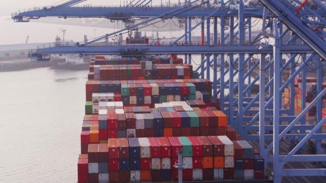 Descending Drone Shot of Cranes Unloading Cargo Ship video