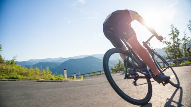 descending on a road bike - veicolo a due ruote video stock e b–roll