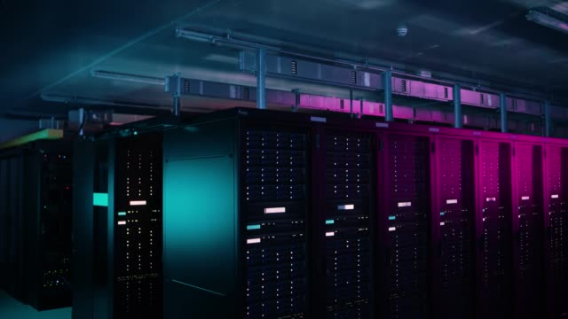 Descending Shot of Data Center With Multiple Rows of Fully Operational Server Racks. Modern Telecommunications, Cloud Computing, Artificial Intelligence, Database, Supercomputer Technology Concept. Shot in Dark with Neon Blue, Pink Lights. Descending Shot of Data Center With Multiple Rows of Fully Operational Server Racks. Modern Telecommunications, Cloud Computing, Artificial Intelligence, Database, Supercomputer Technology Concept. Shot in Dark with Neon Blue, Pink Lights. Shot on RED EPIC-W 8K Helium Cinema Camera. supercomputer stock videos & royalty-free footage