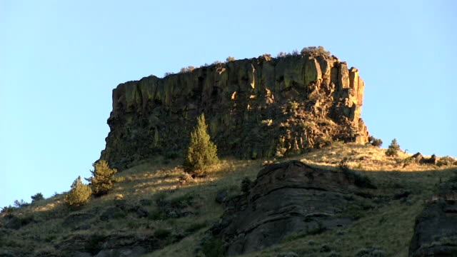 Desert cliff mountain formation with shadowing zoom in video