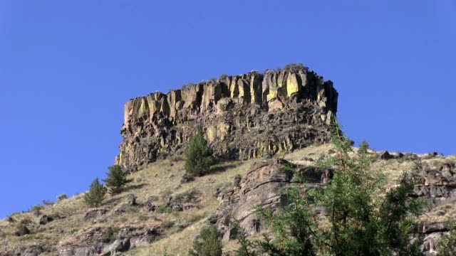 Desert cliff mountain formation with sunshine zoom in video